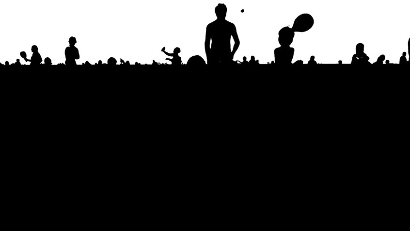 A back and white silhouette of people on the beach