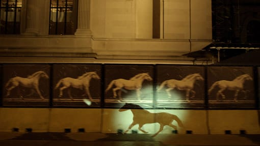 Projection of a silhouette of a horse over the Metropolitan Museum of Art