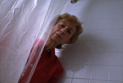 A woman peaking behind a shower courtain