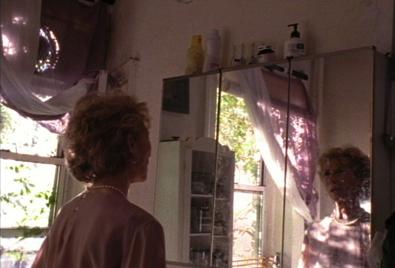 A woman talking into a mirror