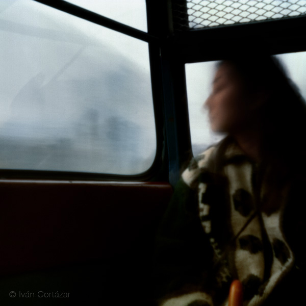 A pinhole photograph of a woman on a cablecar