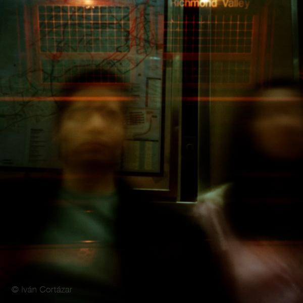 A pinhole photograph of a couple riding the subway