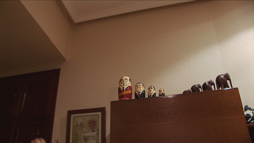 A living room with a mixture of communist and elephant figurines