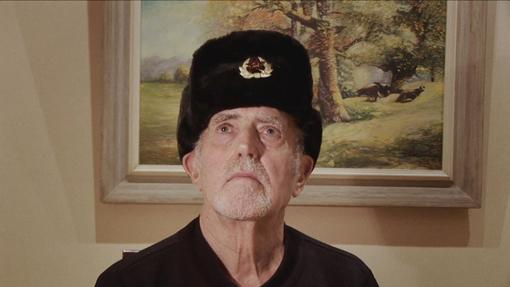 A senior man with a communist hat
