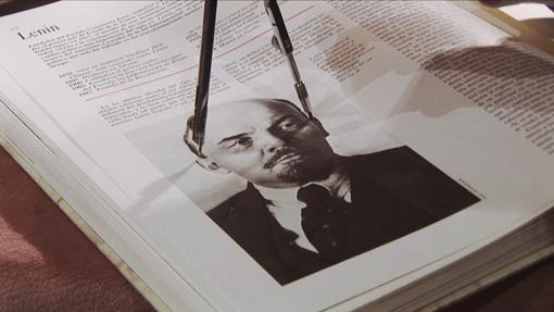 A compass on an image of Lenin