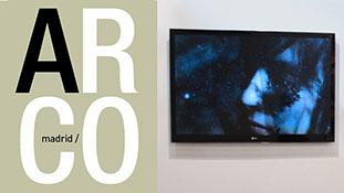 TV displaying a woman sleeping under water. The Logo of ARCO on the left side.