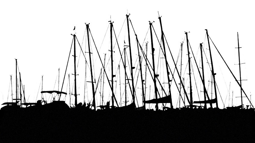 A back and white silhouette of sailboats