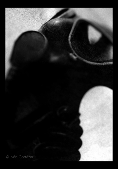 A black and white photo of a newspaper image of a gas mask.