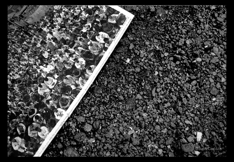A black and white photo of a newspaper with Iraqi war imaginary on the pavement.